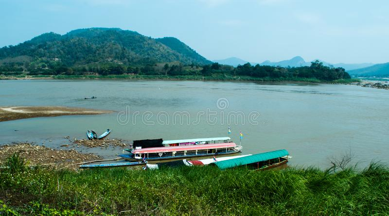 Mountain view and Boats for the tourist at Kaeng Khood Khu,Chiang Khan,Loei,the famous place in north east Thailand. stock image