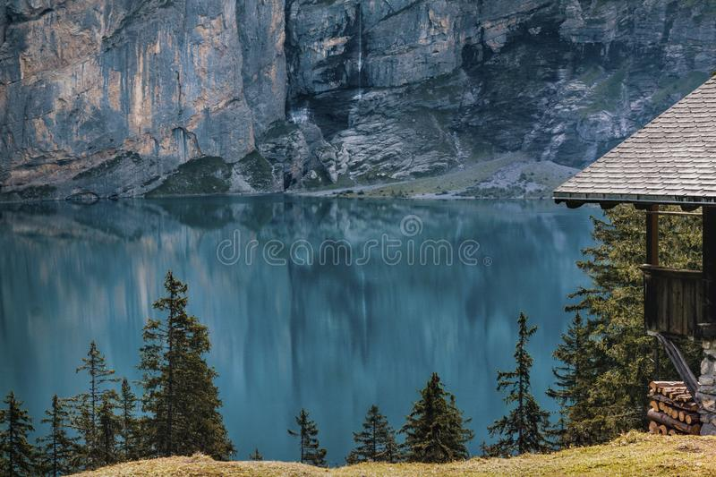 Mountain lake and cabin stock photography