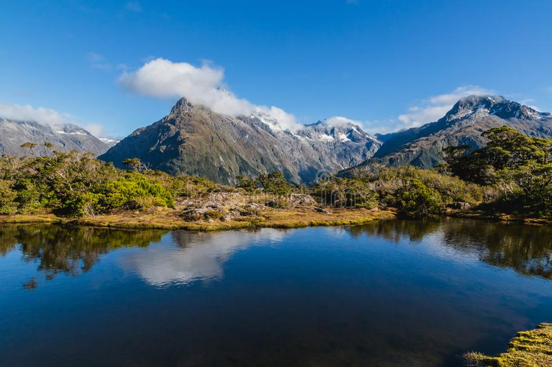 Mountain lake and clouds , Key Summit Trail, Routeburn Track, New Zealand. Mountain lake and clouds at Key Summit Trail, Routeburn Track, New Zealand stock photos
