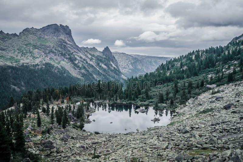 Mountain lake in cloudy weather and mountain valley. Siberia stock photos