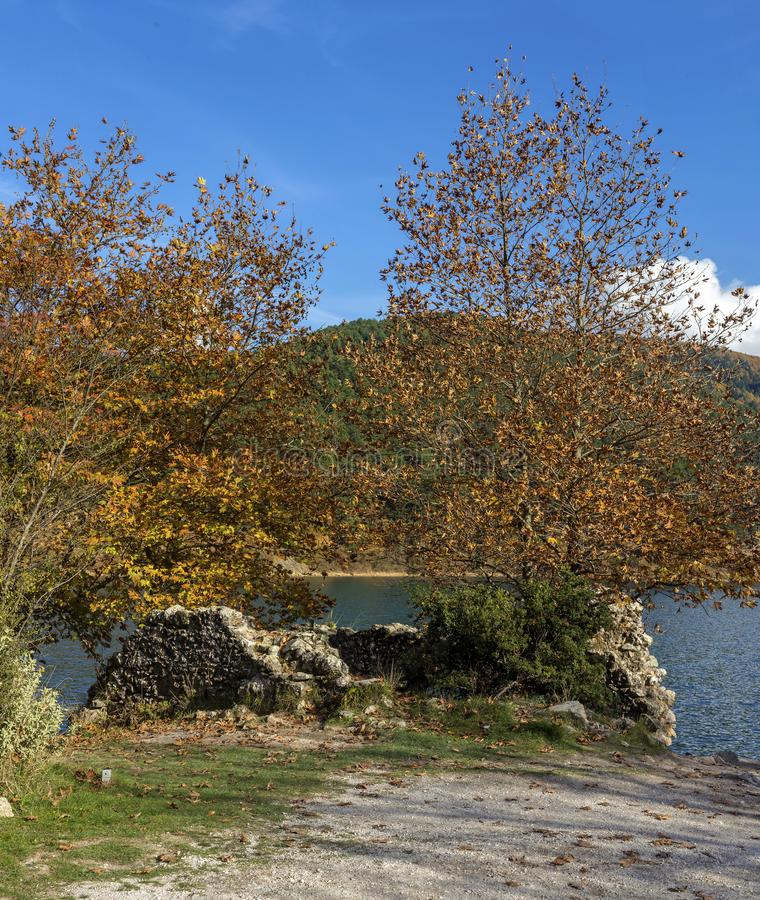 Mountain lake Doxa and the ruins of an ancient church Greece, P. View of the blue, clean, mountain lake Doxa and and the ruins of the ancient church Greece royalty free stock image