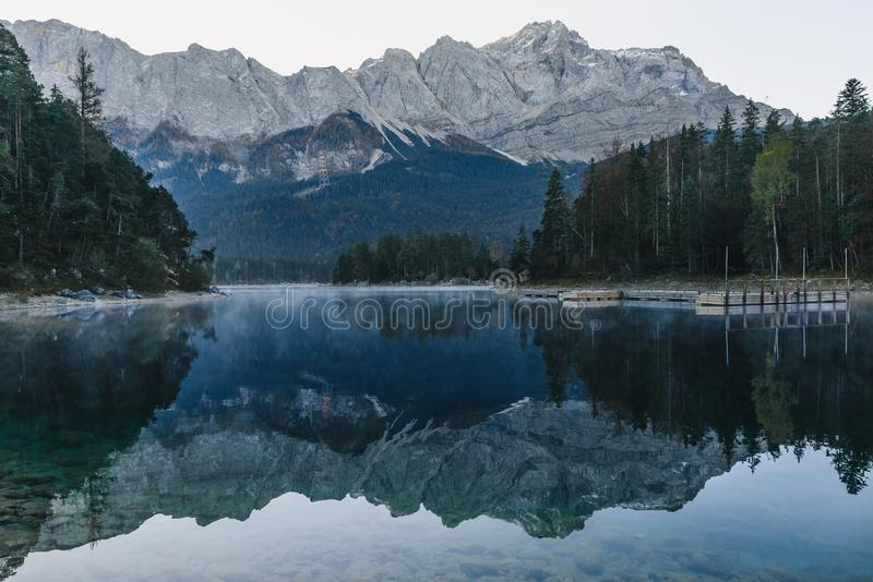 Mountain lake Eibsee in Bavarian Alps in the morning with reflection, Germany. Europe stock photography