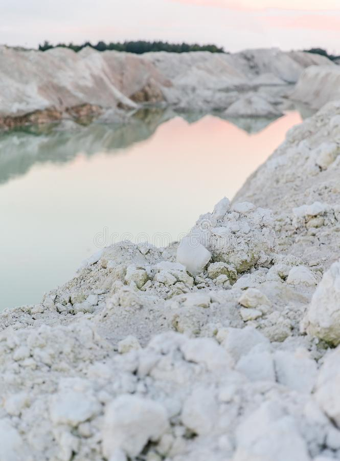 Mountain lake with emerald water at sunset stock photos