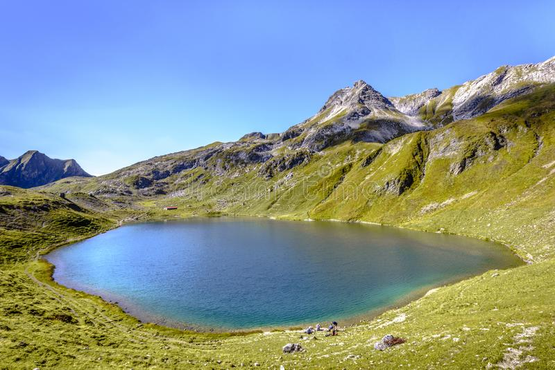 Mountain Lake Engeratsgundsee and Grosser Daumen Mountain against blue sky, Bad Hindelang, Bavaria, Germany stock images