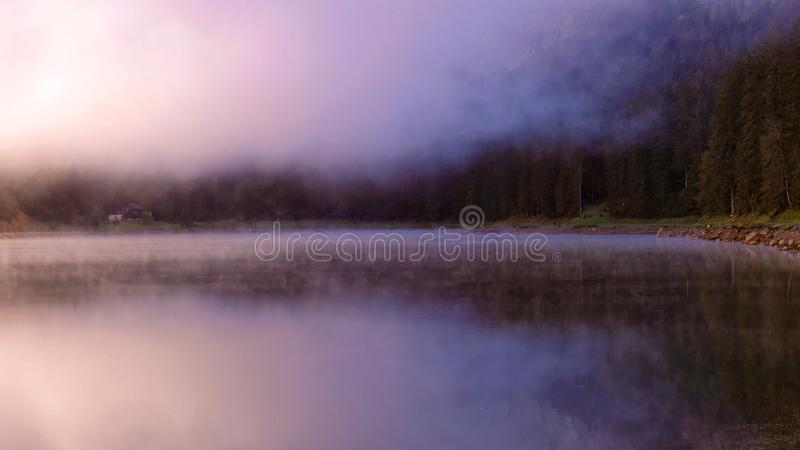 Mountain lake with fog, forest royalty free stock photography