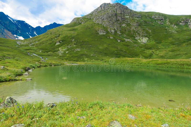 Mountain lake green waters. Valley of 7 lakes. Altai Mountains, Russia. Mountain lake green waters. Valley of 7 lakes. Altai Mountains stock image