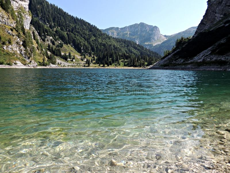 Mountain lake krn in the alps stock photography