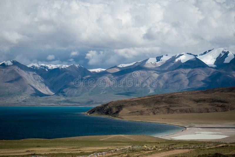 Mountain Lake Manasarovar Himalayas Tibet. Mountain lake Manasarovar lies at 4,590 metres above mean sea level. Manasarovar is said to be the worlds highest stock photos