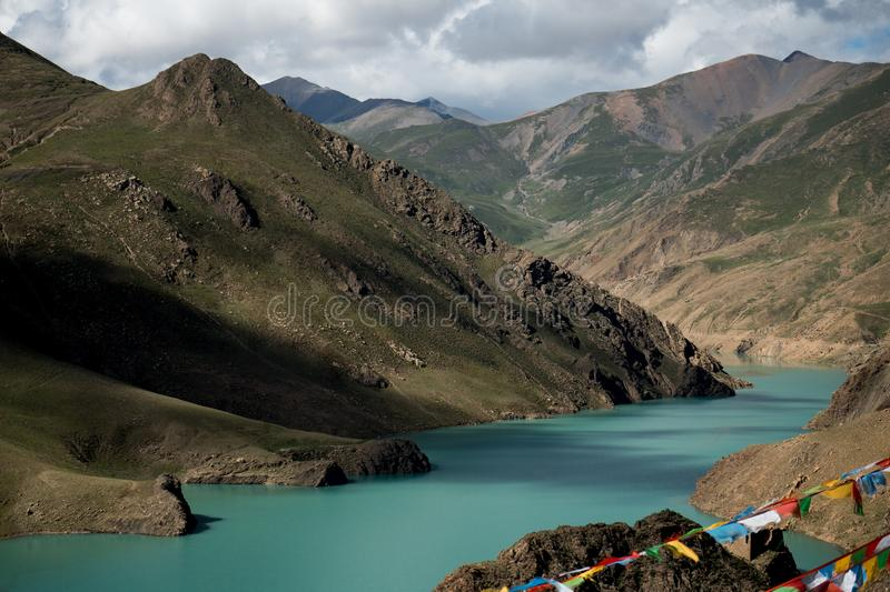 Lungta above Mountain Lake Himalayas Tibet stock photo