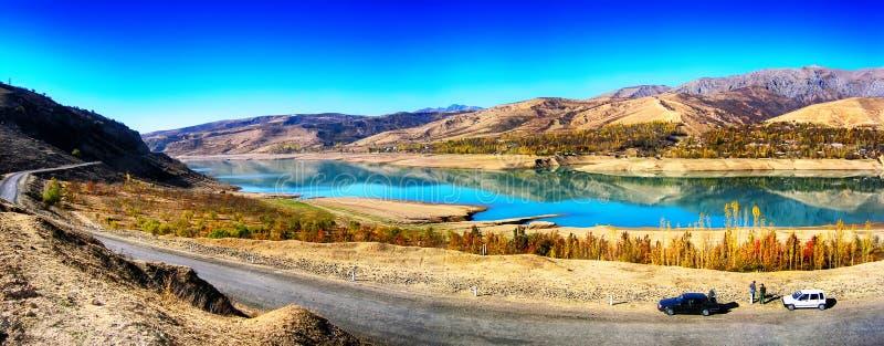 Mountain Lake in the morning. Charvak reservoir in Uzbekistan stock photography