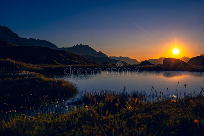 Mountain Lake in the Morning. With a blue sky and the rising sun royalty free stock photography