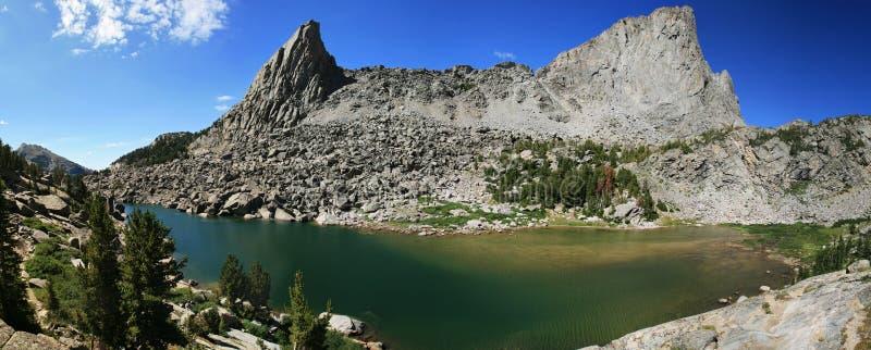 Mountain lake panorama stock photos