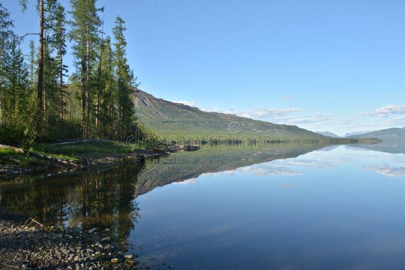 Mountain lake in the Putorana plateau stock image