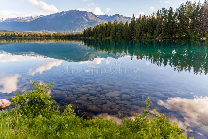 Mountain and Lake with reflection and stones stock photos