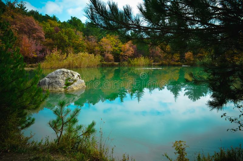 Mountain lake Shaan-kaya, Crimea. Very beautiful mountain lake, against the backdrop of the mountains, autumn landscape. For royalty free stock photos
