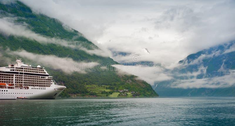 Mountain lake with ship royalty free stock photos