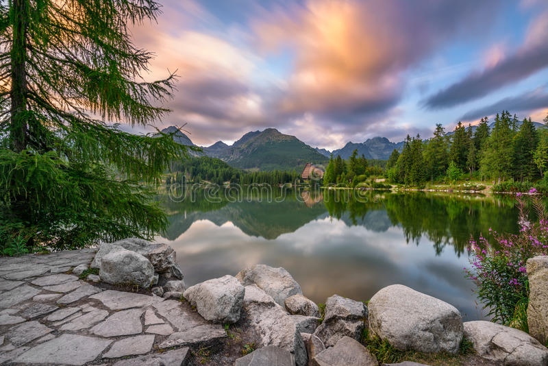 Mountain lake Strbske Pleso in National Park High Tatra, Slovaki. Glacial mountain lake Strbske Pleso in National Park High Tatra, Slovakia. Long exposure stock images
