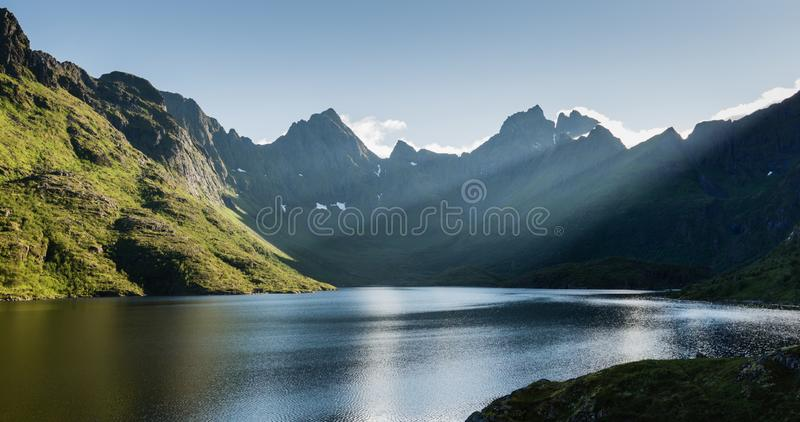 Mountain Lake and Sunlight - Agvatnet, Lofoten Islands, Norway stock photos