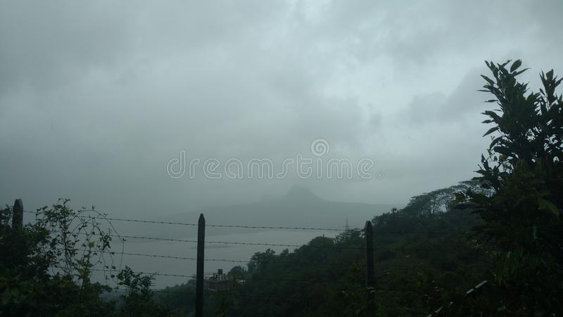 Mountain lake view in foggy weather stock images