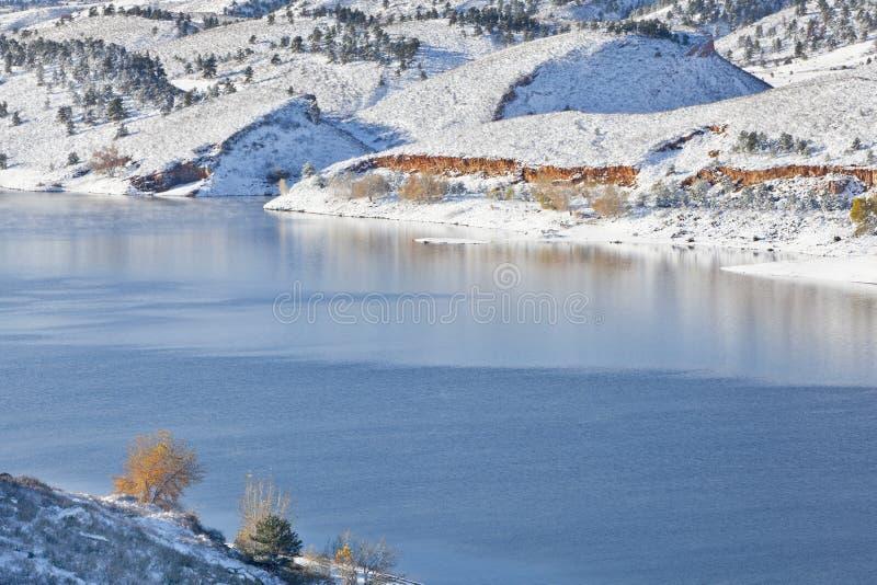Mountain lake in winter scenery stock image