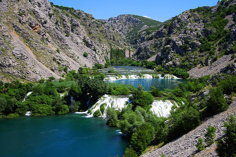 Mountain lakes with the cascade of waterfall stock photography