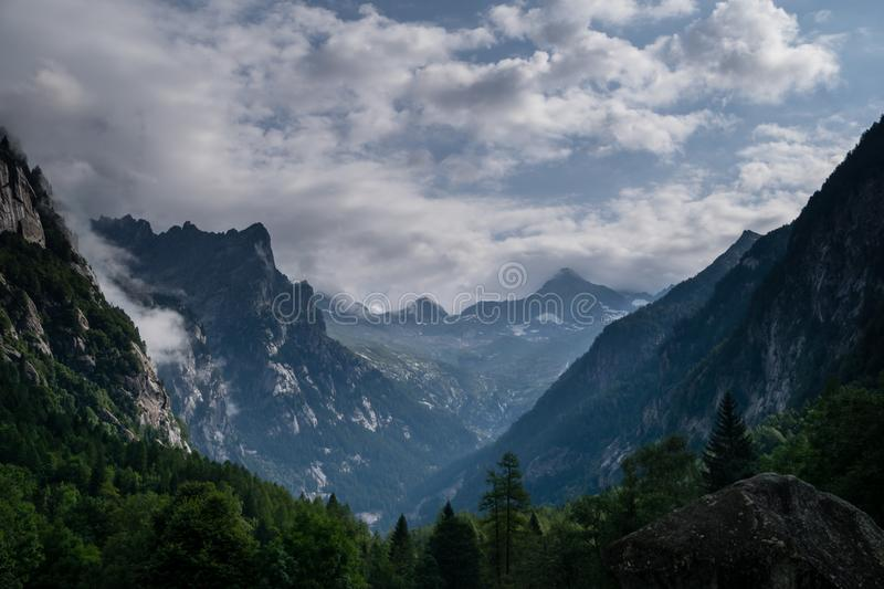 Stormy clouds leaving the mountains stock photos