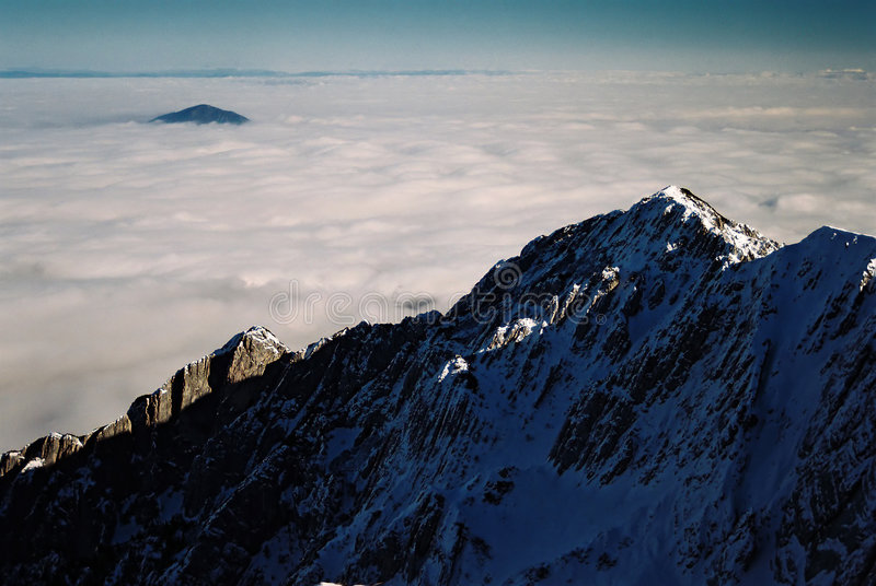 Mountain landscape. Beautiful mountain landscape seen from above the clouds royalty free stock photo