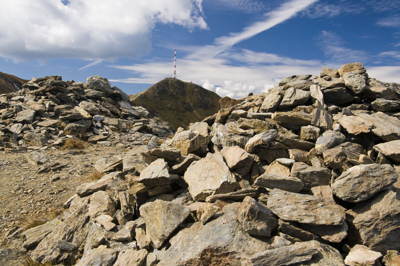 Mountain Landscape. Stones on top of the mountain with antenna in Austria 2007 stock images