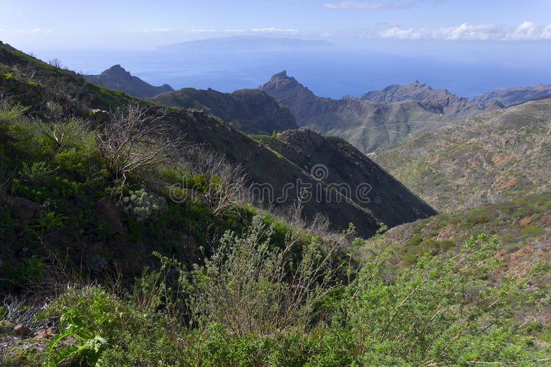 Mountain landscape. Around cottage Masca, Tenerife, in the distance Island La Gomera, Canary Islands, Spain royalty free stock photo