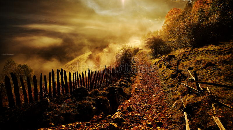 mountain landscape with autumn morning fog at sunrise - Fundatura Ponorului, Romania royalty free stock photography