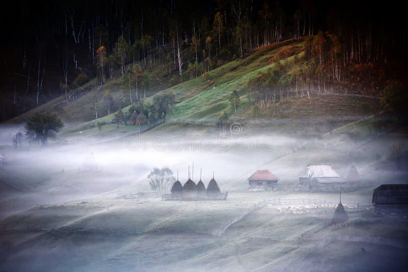 Mountain landscape with autumn morning fog at sunrise. Fundatura Ponorului, Romania royalty free stock photo