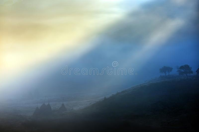Mountain landscape with autumn morning fog at sunrise - Romania stock images