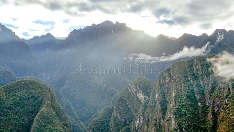 Mountain landscape background with peruvian Andes mountains in the clouds. Mountain background with peruvian Andes mountains in the clouds, green landscape of royalty free stock photo