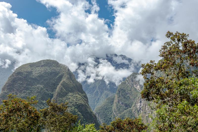 Mountain landscape background with peruvian Andes mountains in the clouds. Mountain background with peruvian Andes mountains in the clouds, green landscape of stock images