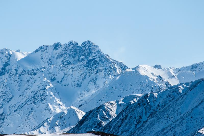 Mountain peaks on blue sky background, Snow capped mountains, Winter landscape in New Zealand stock photo