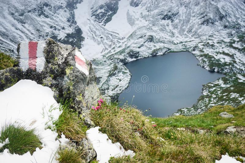 Mountain landscape with blue lake and snow stock photography
