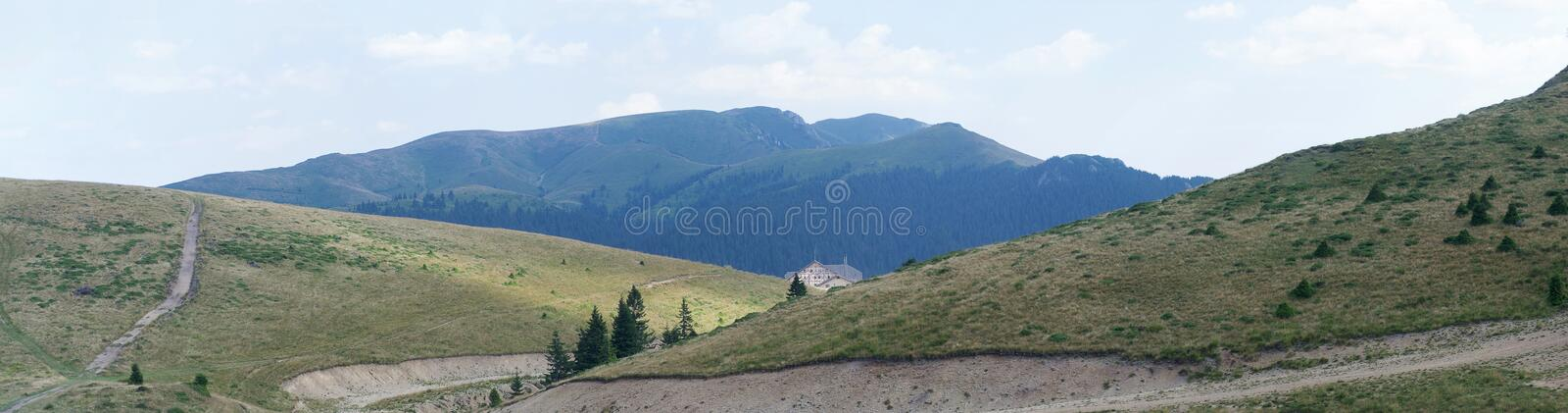 Mountain landscape with chalet in the background royalty free stock images