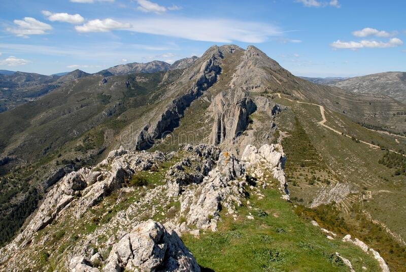 Mountain landscape, with craggy ridges and peaks, Spain. View from Penya Castellet to the surrounding mountains in the Marina Alata area, near Castells de stock photos