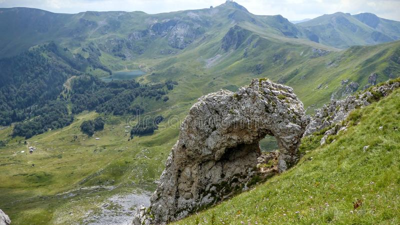 Mountain landscape with in foreground a rock to form of elephant in a natural park of Montenegro. Travel destination. Summertime and holidaytime. Field of royalty free stock photos