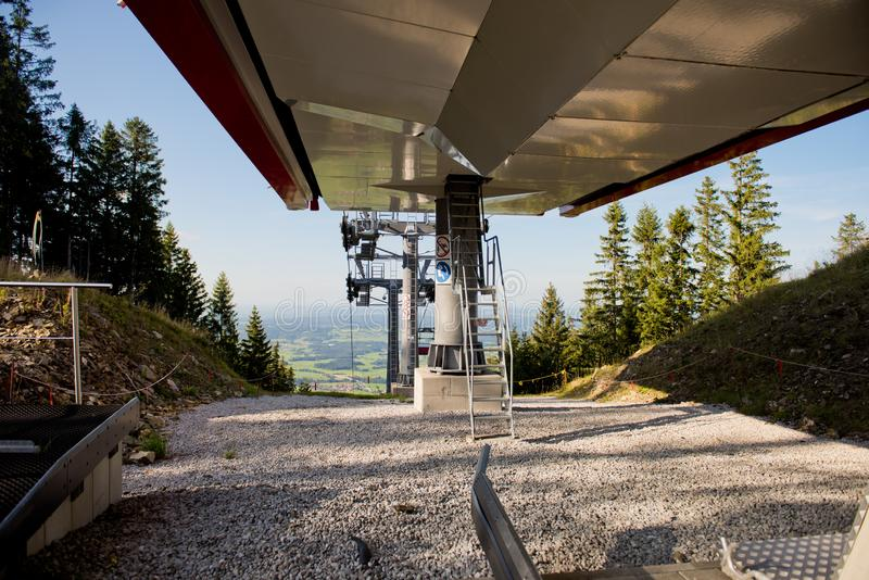 Mountain landscape with forest and ski lift. Mountain landscape with forest and ski lift on a sunny day stock photo