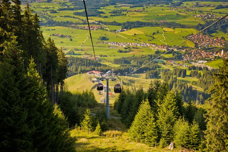 Mountain landscape with forest and ski lift on a sunny day. Nature background royalty free stock photography