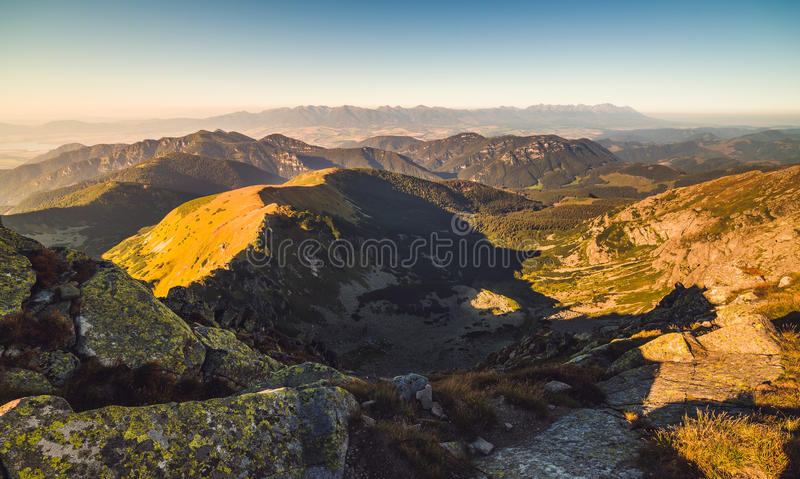 Mountain Landscape in Golden Light. Evening Mountain Landscape with Rocks in Foreground. View from Mount Dumbier in Low Tatras National Park, Slovakia royalty free stock photos
