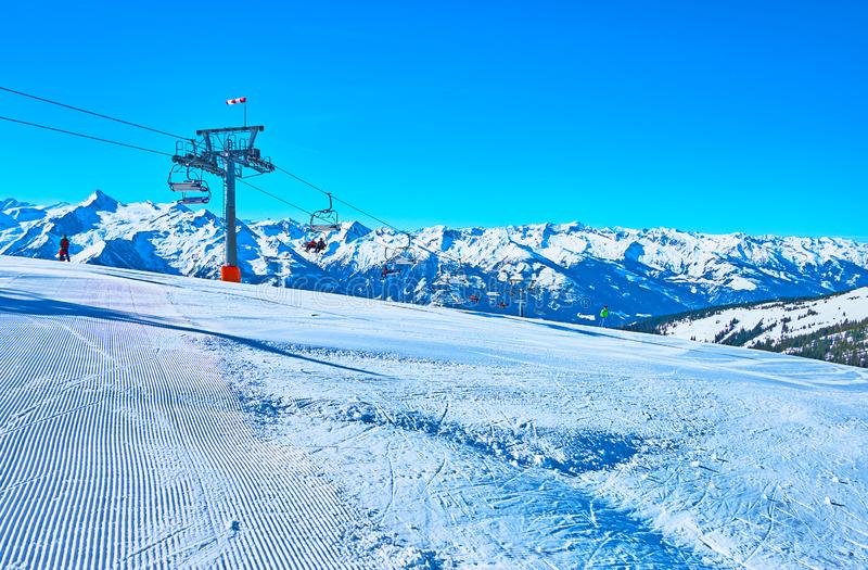 The mountain landscape with groomed piste, Schmitten mount, Zell am See, Austria stock photography