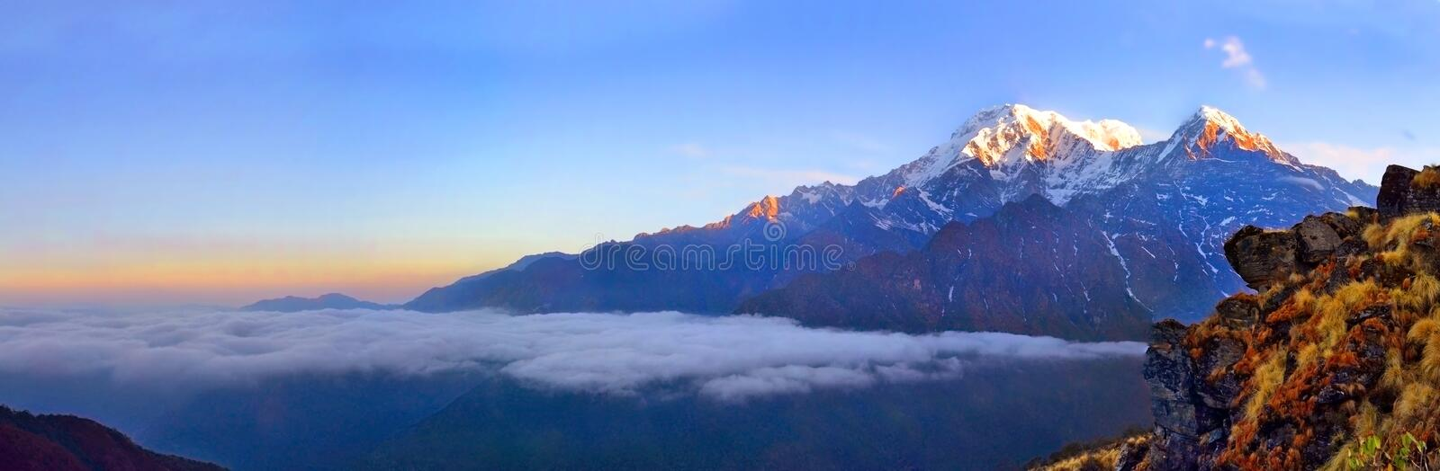 Mountain Landscape in Himalaya. Above clouds. Annapurna South peak. stock photo