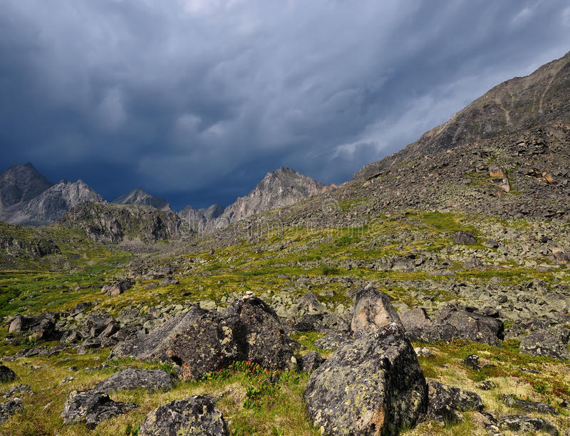 Mountain landscape in inclement weather. Summer mountain landscape in inclement weather. Sayan mountains. Republic of Buryatia stock photo