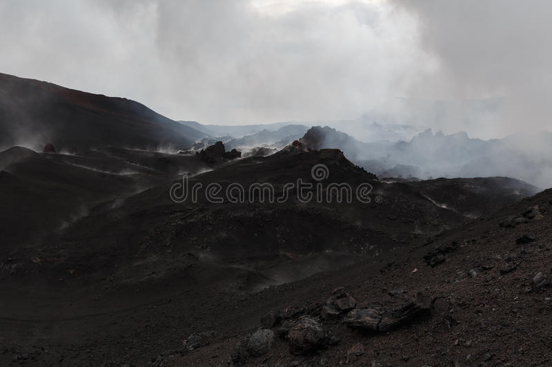 Mountain landscape of Kamchatka: a volcanic eruption area. Grim mountain landscape of Kamchatka Peninsula: volcanic eruption area Tolbachik Volcano royalty free stock images
