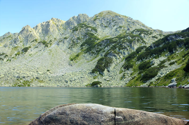Mountain landscape with lake stock photography