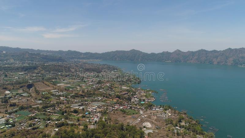 Mountain landscape lake and volcano Batur. Aerial view crater lake and volcano Batur mountain landscape with volcanoes, lake with sky and clouds Bali, Indonesia stock images