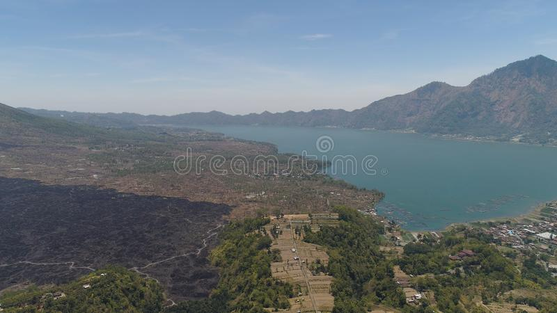 Mountain landscape lake and volcano Batur. Aerial view crater lake and volcano Batur mountain landscape with volcanoes, lake with sky and clouds Bali, Indonesia royalty free stock photos