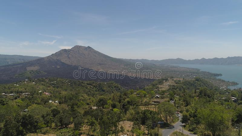 Mountain landscape lake and volcano Batur. Aerial view crater lake and volcano Batur mountain landscape with volcanoes, lake with sky and clouds Bali, Indonesia royalty free stock image